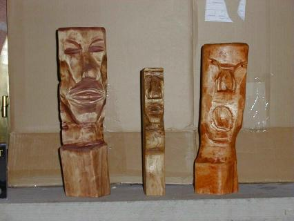 Various carved 'tiki' heads